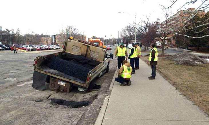 truck in pothole